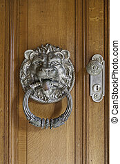 Lion knocker on a door