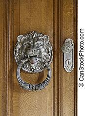 Lion knocker on a door