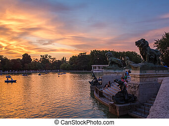 Lion sculptures in Buen Retiro park lake, Madrid - Lion...
