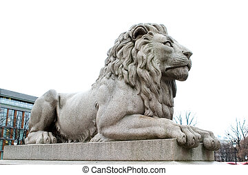 Lion Statue - A lion statue sits majesticaly on it\\\'s...