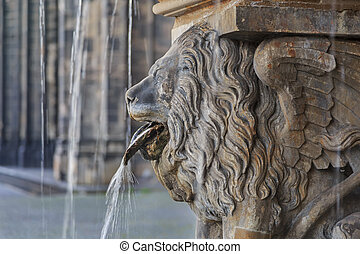 Lion statue and fountain on the square near Cologne cathedral