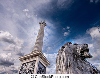 Lion Statue at Trafalgar Square against dramatic sky,...