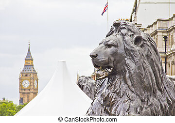 Lion statue in the Monument and the Big Ben, London