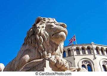 Lion statue near Norwegian parliament Storting Oslo, Norway