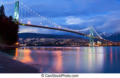 The lions gate bridge in Vancouver at Dusk.