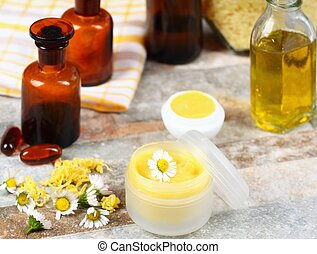 Homemade balm on lips decorated with daisy flowers
