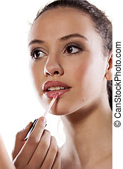 lip gloss applying - young girl applied lip gloss