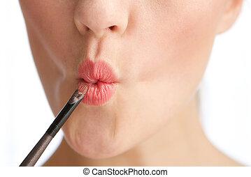 Lip gloss make up application - Close up portrait of a half ...