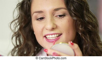 Lip Make-up - Extreme close up of girl applying lip gloss...
