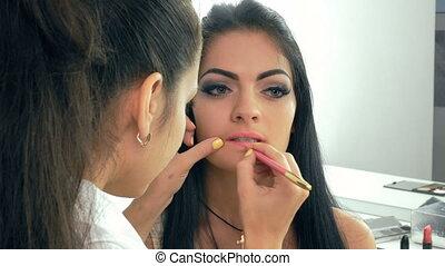 lip makeup. makeup artist - makeup artist doing makeup for...