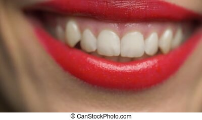 lips or mouth of smiling woman with red lipstick - beauty,...