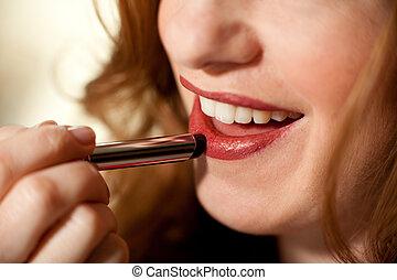 Lipstick application close-up
