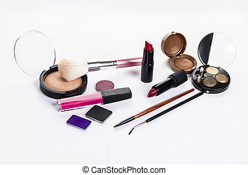 lipstick, eye shadow, makeup brushes on a white background
