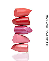 close up of a lipstick stack on white background