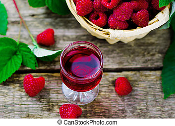 liqueur from raspberry in a shot glass - liqueur from ...