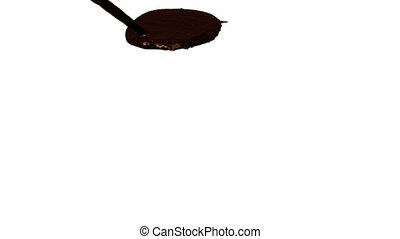 liquid chocolate flow falls on surface