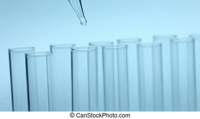 Liquid dripping from pipette into test tube