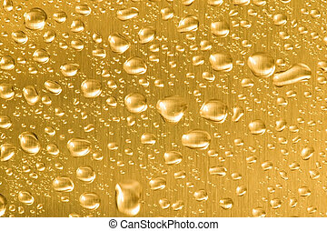 Liquid Gold - Gold metal with water droplets on.