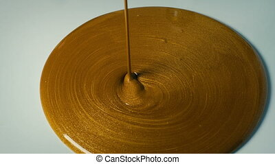 Liquid Gold Pouring On Surface