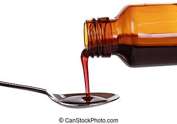 Liquid medicine in a bottle - Liquid medicine pouring from a...