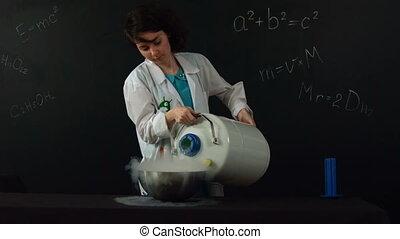 Liquid nitrogen pouring. Slow motion - A lab technician...