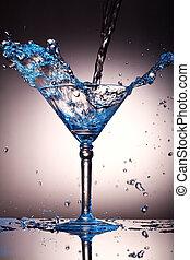 Liquid splash in a martini glass