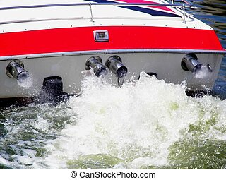 Liquid Thunder - Water churning in back of power boat.
