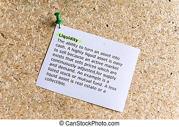 liquidity word typed on a paper and pinned to a cork notice...