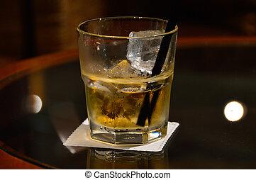 Liquor glass on saloon table