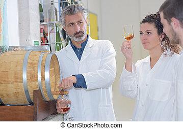liquor maker shows to experts a glass of armagnac