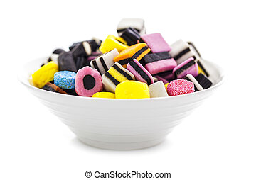 liquorice allsorts in a bowl isolated on a white background