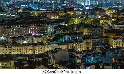 Lisbon aerial panorama view of city centre with illuminated building at Autumn night timelapse, Portugal