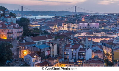 Lisbon after sunset aerial panorama view of city centre with red roofs at Autumn day to night timelapse, Portugal