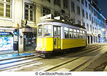 Lisbon at night, famous tram, historic streetcar is running
