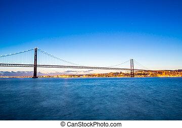 Lisbon Bridge at dusk - Lisbon cityscape with 25 de Abril...