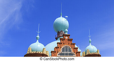 Blue domes and red bricks of the famous Campo Pequeno bullring of Lisbon, Portugal, built in 1890 in neo-Mudejar style.