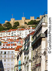 Castle of Sao Jorge towering above the houses on a summer day in Lisbon, Portugal
