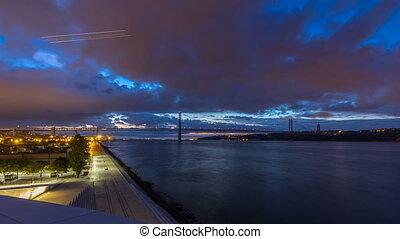Lisbon city before sunrise with April 25 bridge night to day...