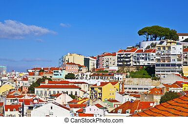 Lisbon panorama, Portugal. Buildings, roofs, churches at blue sky