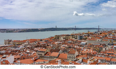 Lisbon roofs timelapse with Tagus river and suspension...