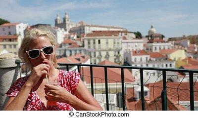 Lisbon tourist viewpoint - Happy tourist woman drinking ...