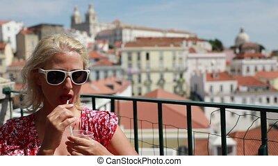 Lisbon tourist viewpoint - Nice tourist girl drinking orange...