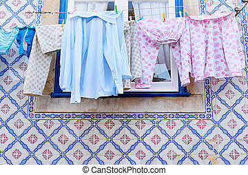 Drying clothes hanging on a clothesline in Lisbon, Portugal
