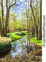 Beautiful landscape with a pond in park Keukenhof (Netherlands)