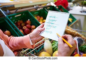 List of products - Image of senior woman hands holding...
