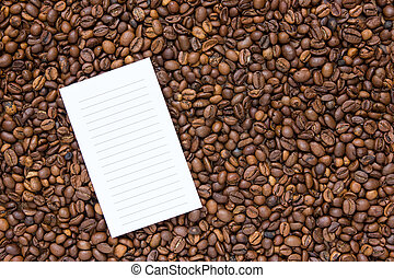 List on the background coffee beans