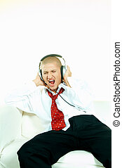 Listen to music - Businessman relaxing on couch and listen...