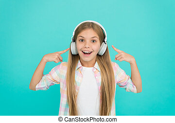 Listening to her favorite song. Music makes her happy. Little girl child listening to music. Happy little child enjoy music playing in headphones. Adorable music fan