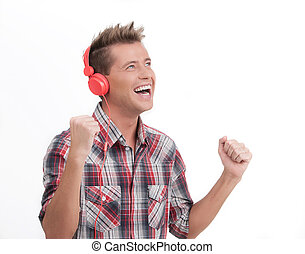 Listening to his favourite music. Happy young man in headphones listening to the music and gesturing while isolated on white