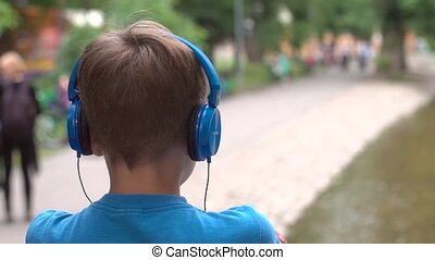 Listening to music on headphones in the park